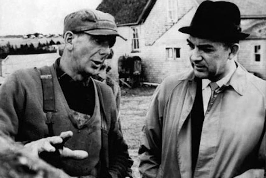 Alex Campbell, right, campaigns in rural P.E.I. during the early days of his successful career as premier. (File Photo)