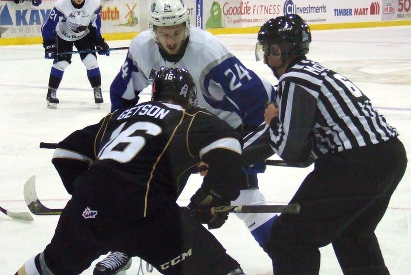 Cedric Parre (24) of the Saint John Sea Dogs faces off against Keith Getson of the Charlottetown Islanders in Quebec Major Junior Hockey League action Thursday in Charlottetown. The Isles won 3-2. Charles Reid/The Guardian
