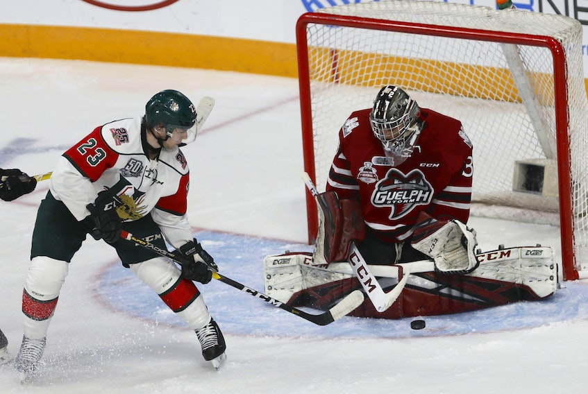 Halifax Mooseheads centre Keith Getson is stymied by Guelph Storm goalie Anthon Popovich during Memorial Cup action in Halifax.