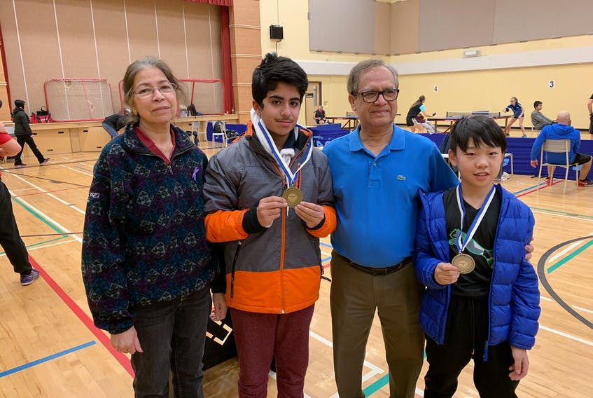 P.E.I.'s table tennis team brought home four medals from a tournament in Musquodoboit this week in Nova Scotia. From left, are Farida Chishti manager; Zaeem Arif, gold medal in Division F; coach Najam Chishti; and Mike Li, silver medal winner in Division E.
