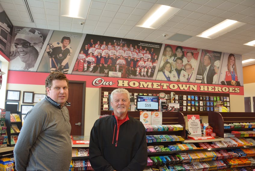 Ryan Simmonds, site manager with Mel's Petro Canada on Granville Street in Summerside, with city native and former NHLer Errol Thomspon. Thompson is one of a number of local sports icons Mel's is honouring at its store. Photo by Colin MacLean