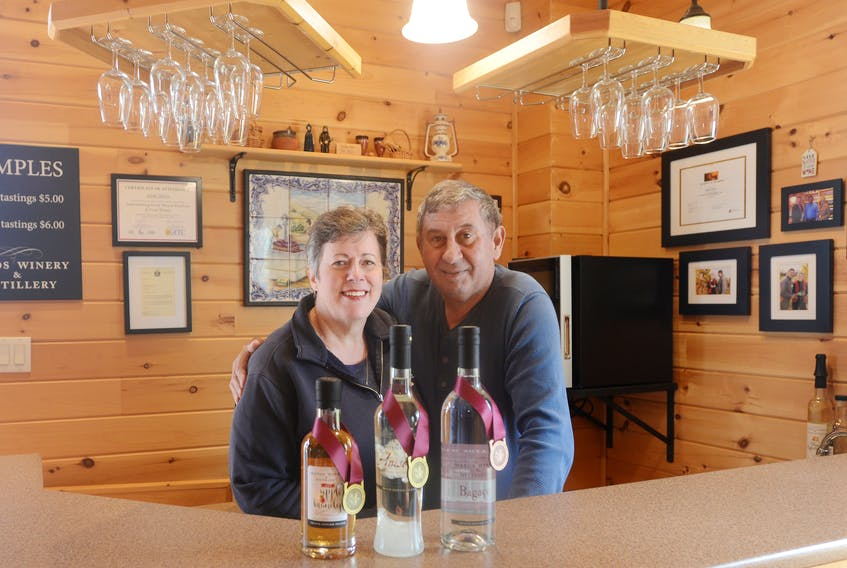 Heather and Jamie Matos show their award-winning products, from left, Anisette, P.E.I. Apple Brandy and Bagaco. The couple recently won two gold medals and a bronze in the Canadian Artisan Spirit competition in British Columbia and are preparing for the upcoming summer season.