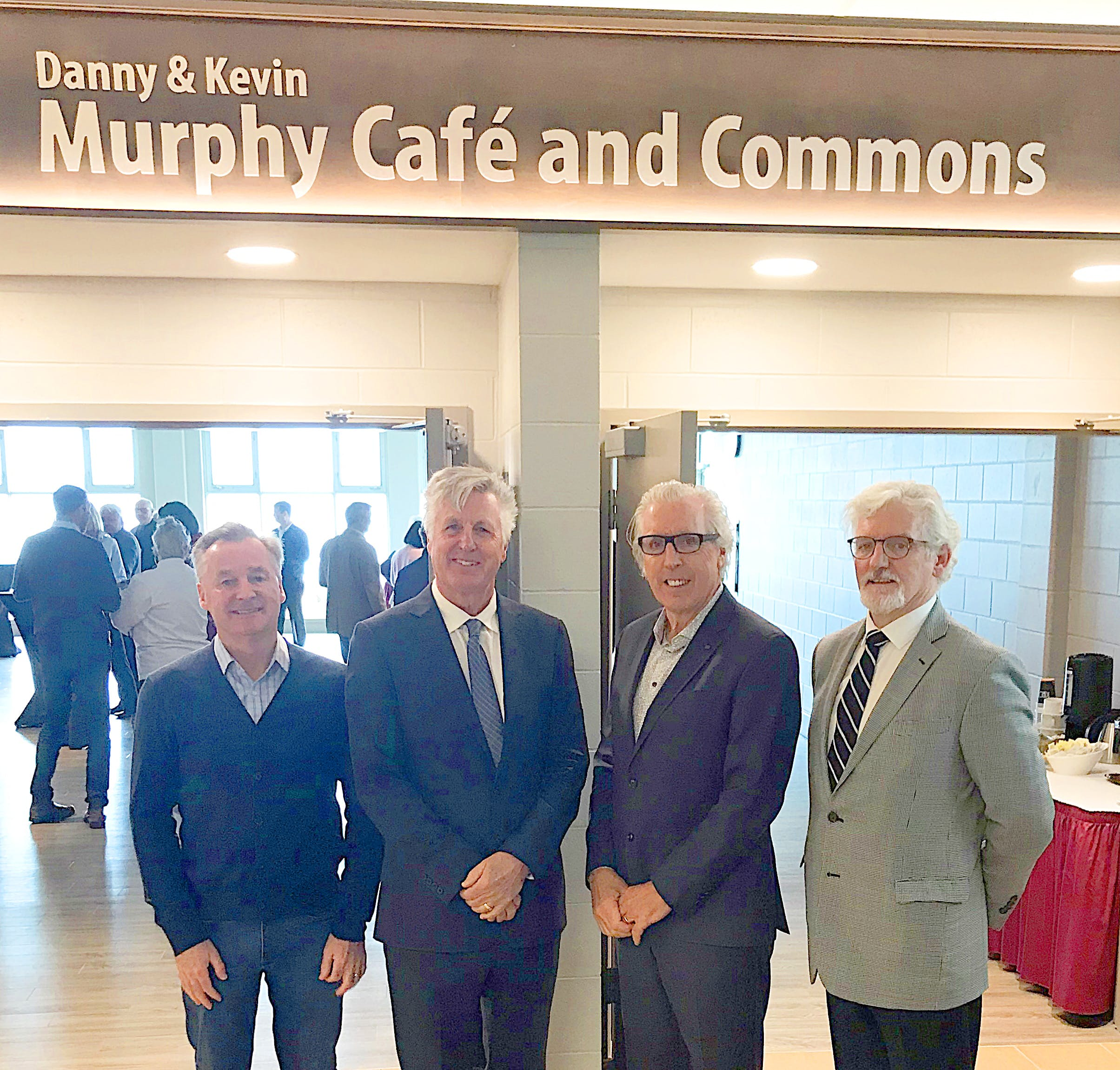 Holland College foundation board chairman Ron Keefe, left, and Holland College president Sandy MacDonald, right, congratulate leadership donors Danny and Kevin Murphy, centre, on the naming of the Danny and Kevin Murphy Café and Commons at the college's Tourism and Culinary Centre in Charlottetown.