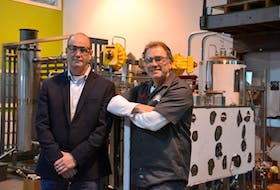 David Campbell, left, and Peter Toombs of Advanced Extractions Systems Inc. in Charlottetown recently received the emerging business award from the Greater Charlottetown Area Chamber of Commerce.