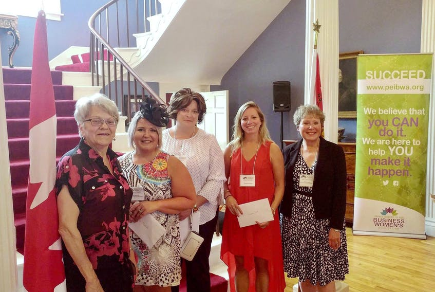 Lt.-Gov. Antoinette Perry, from left, hosted P.E.I. Business Women's Association micro-grant winners Krista MacLeod, Jackie Herbert and Suzanne Scott along with BWA executive director Margaret Magner at a recent Fanningbank reception for the organization. Micro-grant winner Amber Jadis was unable to attend.