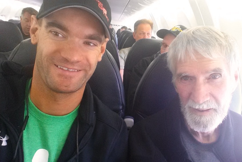 Jimmy Lefebvre is shown on a flight with his father, Simon, about a month before Simon's death in 2016. Lefebvre and members of his family are nearing an end of a cross-Canada walk from Grande Prairie, Alta., to Simon's resting place in Palmer Road, P.E.I. In their Can-Survive walk, they are raising money in Simon's memory for cancer research and to support cancer patients and their families.
