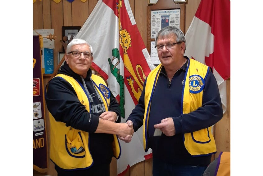 Summerside King Lion Edwin Gallant, left, presents Lion Roger Richard with the Gold Centennial Membership Award. The presentation took place at a recent meeting.