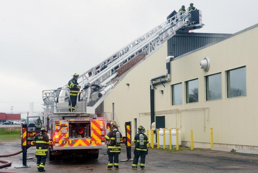 City firefighters respond to a blaze inside the Charlottetown Mall on Sunday.