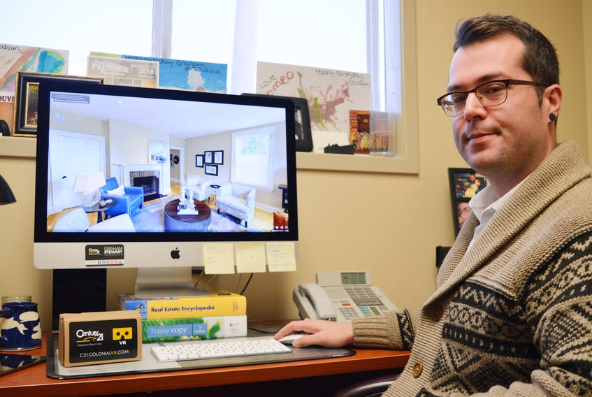 Graham Stewart, manager of marketing and digital services for Century 21 in Charlottetown, says real estate companies are now using virtual technology to help sell homes. It gives the customer the feeling of being inside a home that's for sale without actually setting foot in it. DAVE STEWART/THE GUARDIAN