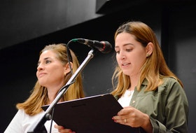 Karina Navarro and her daughter Mariana Navarro lost a mother and grandmother in the Swissair crash. They're shown reading from a plaque of appreciation they presented to emergency responders and local residents at Blandford Community Centre on Sunday.
