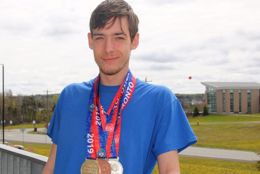Jason Hicks took part in the first Special Olympics Youth Invitational Games, which were held in Toronto in May. He won three medals and set a personal best during the games.