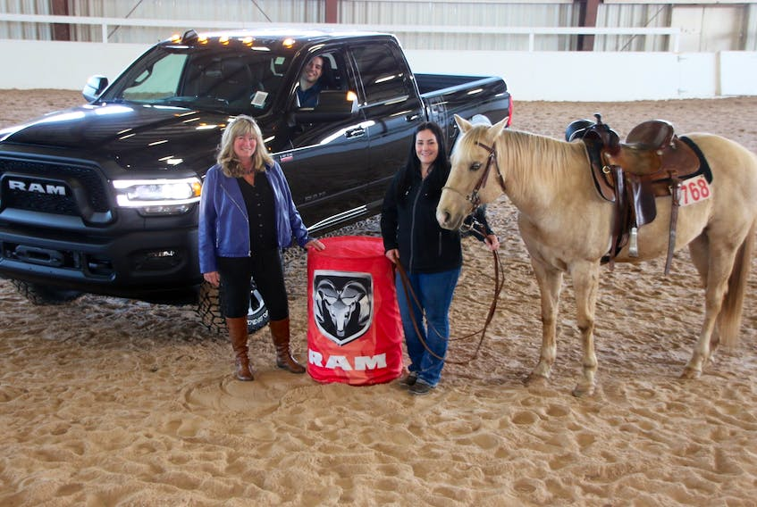 Preparations are underway for the 2019 Ram Rodeo Tour. Some of those involved are, from left, Darrelyn Hubley, Nova Scotia Provincial Exhibition manager, Daniel Morrison, of Blaikies Dodge Chrysler, Tracey Higgins, Maritime Barrel Racing Association president, and her horse Iza Wicked Wind. LYNN CURWIN/TRURO NEWS