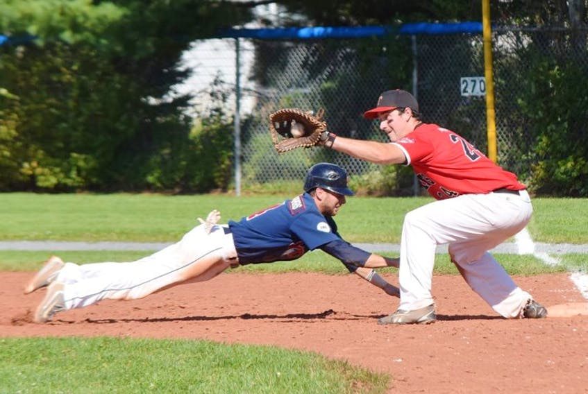Chris Farrow of the Sydney Sooners manages to get back to the bag just before Truro Bearcat Dan Bates can put the tag on him during a pick-off attempt in Saturday's NSSBL playoff game in Truro. The Sooners thumped the Bearcats 13-2 to go up 2-0 in the best-of five semifinal series.