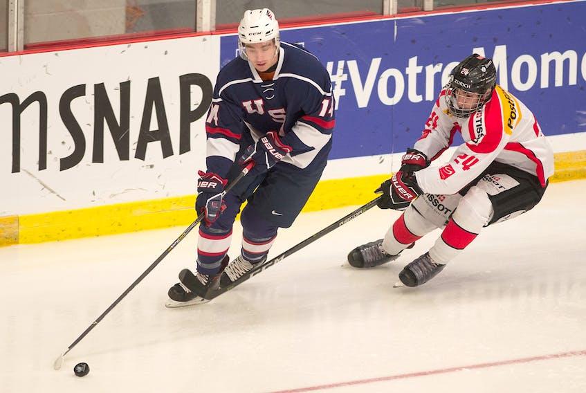 Team USA's Nick Perbix is chased by Switzerland's Mathieu Vouillamoz in first period action of their World Junior A Hockey Challenge quarterfinal game in Truro on Wednesday. Mark Goudge/SaltWire Network