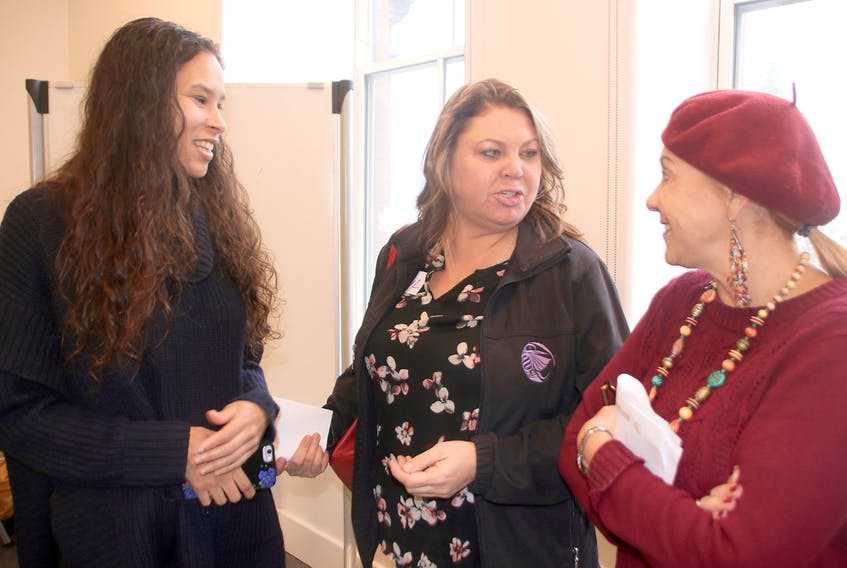 A roundtable was held in Truro this week to focus on feminist issues. From left, El Jones, professor, activist and poet; Cheryl Maloney, former president of Nova Scotia Native Women's Association; and Truro-Bible Hill-Millbrook-Salmon River MLA Lenore Zann chat during a break at the event. Lynn Curwin/Truro Daily News