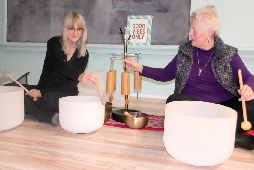 Beth Amyot, left, and Evelyn Patriquin create calming sounds during a 'Vital Relaxation' session. The sessions are held at the Douglas Street Recreation Centre.