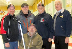 Front row, wheelchair curler Troy Peck; second row, Chuck Patriquin, Neil Peck, Ted Lohnes and Bill Spinney.