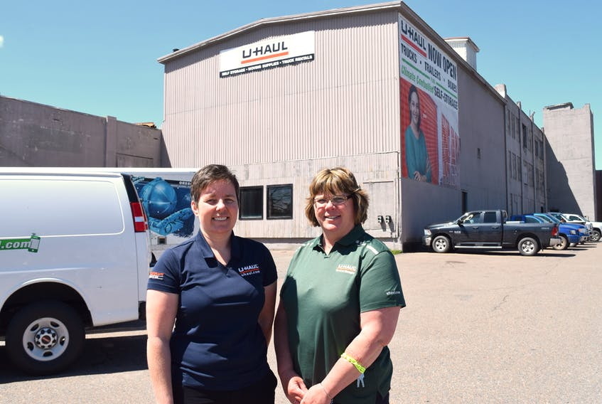 The U-Haul Company, which recently purchased the former Lewis Hat Factory building in Truro, is planning to create several floors of self-storage units as well as renting moving vehicles from the location. Pictured above from left are Tracey Higgs, Atlantic Canada president, and Michele Rees, general manager of the new Truro location.