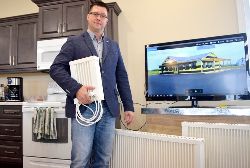 Karsten Irmler, a heating systems specialist, travelled from Germany to showcase and educate the public on the new ELKAtherm electric heaters during a public information session recently at Golden Green in Upper Onslow. Cody McEachern/Truro Daily News