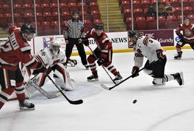 Leon Denny, from Eskasoni Mi'kmaw Nation, looks to block a pass between Crushers' attackers during a Truro-Pictou County battle from earlier this season. Denny, who won a title with the Bearcats in the 2016-17 season, is wearing the 'C' for this year's team.