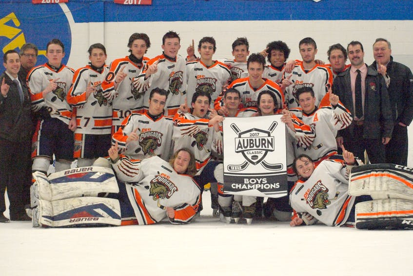 The CEC Cougars went undefeated to win gold at the Auburn Classic boys' high school hockey tournament. Members of the Cougars are, front, from left, Cody Patriquin and Steven Jackson; second row, Aiden Pitcher, Cody MacDonald, Brody Schmitt, Connor Miller and Weston Porter; third row, coaches Tom Whidden and Jeff Hazelton, Rylan McIntyre, Joseph Fagioli, Ryan Rath, Calum MacLeod, Hayden Roy, Cameron DeGroot, Luke Smith, Brayden Gray, Kyle Stuart, Keegan Grady and coaches Andre Robichaud and Vince MacCormack. Absent are Jackson Haight, Matt Melanson and Jeremy O'Connell.