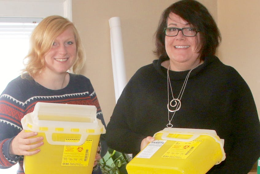Megan Netzke, program assistant at the Northern Healthy Connections Society, left, and Karen Kittilsen Levine, harm reduction co-ordinator, sort through some of the health supplies that recently arrived. Lynn Curwin/Truro Daily News