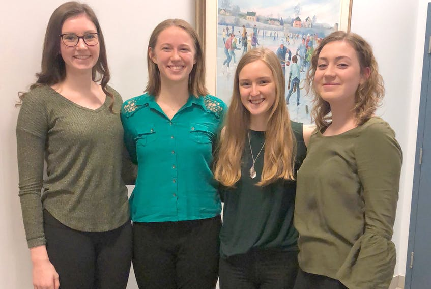 Members of CEC's environmental club are pushing to turn Truro into an idle-free area, by selling idle-free zone signs to local businesses. From left, Reann Post, Tara Cashen, Kathryn MacQuarrie and Kathleen O'Conner, executives of the CEC environmental club.