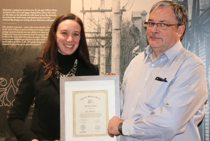 Margaret Mulrooney, curator at the Colchester Historeum, presents an award to Glen Matheson, in appreciation for his work in researching, preserving the history of the Earltown area. He maintains an Earltown heritage blog.