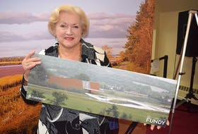 Colchester County Mayor Christine Blair held up one possible concept of a future pedestrian and cyclists' bridge over the Salmon River near Truro.