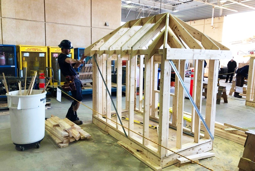 Pomquet's Tanner Doiron in the midst of building his play house at the Nova Scotia Skills Competition, held in Halifax April 5. Doiron won gold at the event and will now compete in the nationals, also in Halifax, later this month.
