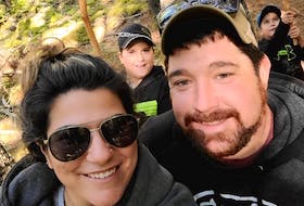 Tim Amero, a third-generation forest worker and owner of Cut Rite Logging in New Edinburgh, poses with his girlfriend, Denise Tardif, and her two boys, Marcien and Miguel.