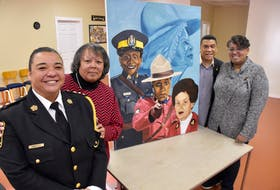 Leanne (MacDonald) Sample, Cathy Thomas, Sgt. Craig Smith and Carmelita (Cromwell) Johnson stand next to a painting by Letitia Fraser that features images of Rose Fortune, Insp. Sherley Goodgie, Const. Carline Fidele and Const. Shelley Peters during an event in Yarmouth County celebrating 'Black Women Making a Difference in Canadian Law Enforcement.' TINA COMEAU PHOTO