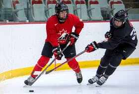 Blayre Turnbull of Stellarton goes into the corner during a Hockey Canada women's hockey camp in Calgary in January. The 2021 IIHF women's world hockey championship in Halifax and Truro has been pushed back a month to May. - Hockey Canada