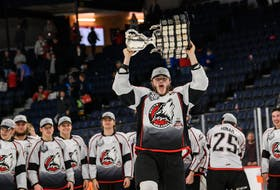 Rouyn-Noranda Huskies defenceman Noah Dobson raises the Memorial Cup for the second time Sunday in Halifax. Vincent Éthier/QMJHL/CHL