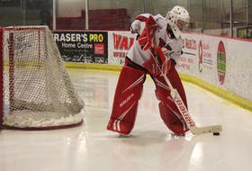 Major bantam goalie Sam Sinclair stops the puck behind his net, in action at the Kings Mutual Century Centre in Berwick. SUBMITTED