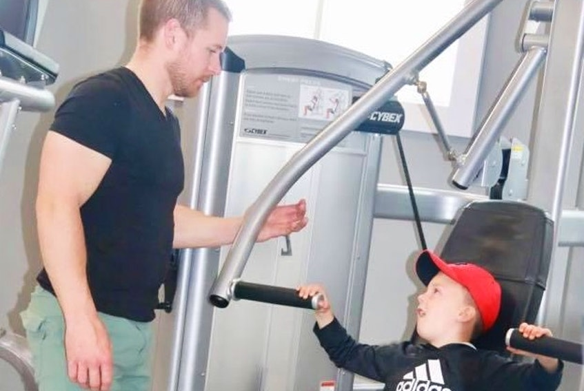 Adam Boyle enjoys sharing his love of working out with his six-year-old son Chase. Boyle and his wife Stacey Burton own Flex Fitness in Deer Lake.