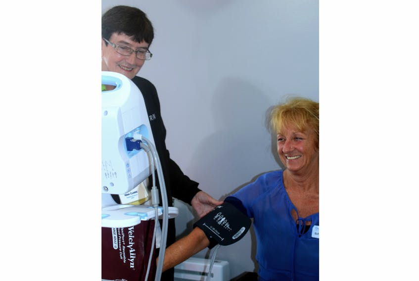 Darlene MacNeil, director of safety, environment and infrastructure, is shown having her blood pressure tested by RN Nina Clarke at the recent Glen Haven Manor Health & Wellness Fair for staff.