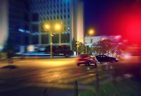 I sat at a red light beside a Costco, a tight knot of an eight-lane roadway crossed by a six-lane one. As the advanced green arrow flashed in both directions, the car to my right simply drove across the red and through the huge intersection, much like what's depicted in this stock photo.