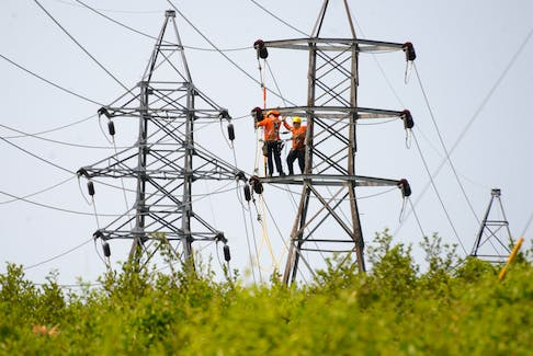 A Newfoundland Power crew goes about repairing a tower in the Massey Drive area Monday in the midst of a prolonged power outage that affected the Corner Brook and surrounding area.