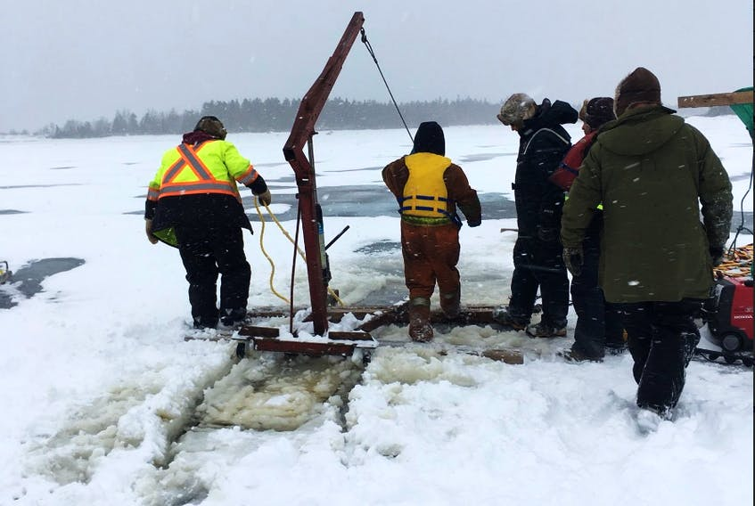 Workers start the task of lifting the intake off the bottom of Sandy Lake. - Photo courtesy Wayne Bennett/Twitter