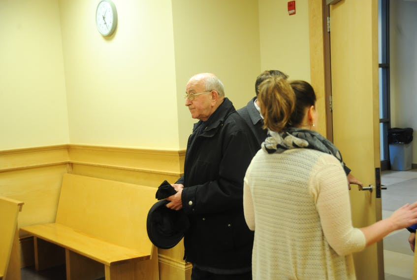 Retired Catholic priest George Smith arrives at provincial court in Corner Brook earlier this week to be sentenced for indecently assaulting an altar boy nearly 40 years ago.