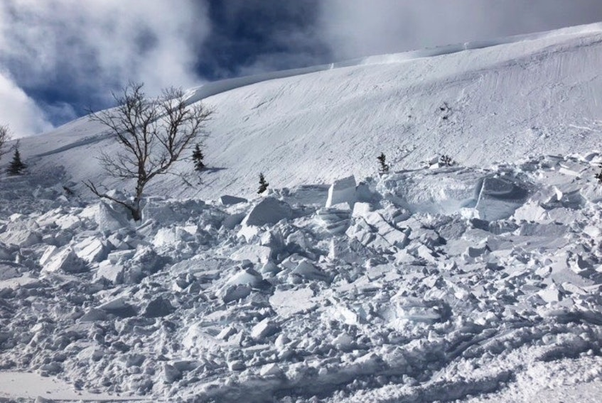 This is the aftermath of an avalanche near Hawkes Bay that caught one snowmobiler in a group riding through the area at the time.