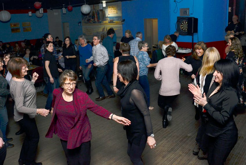 Music continues to be a large part of the Corner Brook Winter Carnival. The dance floor was hopping at the Paws, Trails and Tunes dance at the Seaport Lounge Sunday night. - Photo by Roger Down