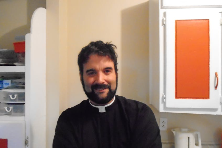 Rev. Mario Menendez struck a chord among pirates, witches, demons and other Hallowe'en spooks who came out for tea and coffee with the parish vicar in McIvers.