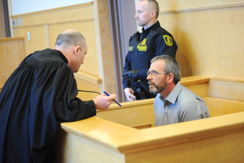 Walter Alfred Joyce, right, talks to his lawyer Robby Ash in the Supreme Court of Newfoundland and Labrador in Corner Brook Thursday, prior to being sentenced to serve two years, less one day, in prison for two counts of impaired driving causing death.