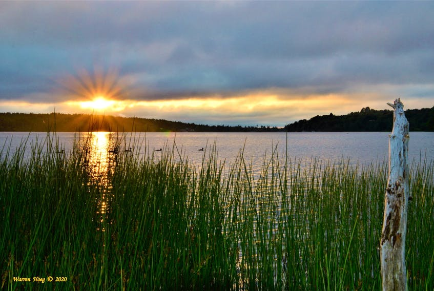 Warren Hoeg watched as the sun came out just long enough to quickly play hide & seek with the incoming clouds and fog. At Lake Loon in Dartmouth, N.S. the sun set at 8:58 p.m. on Sunday.