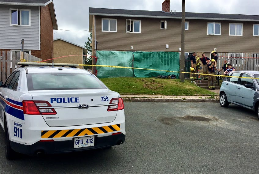 Tarps surround the house on Cowperthwaite Court in St. John's, where the body of a woman was found this afternoon. — Photo by Rosie Mullaley/The Telegram