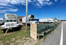 Seafood company trucks have been parked in front of the DFO detachment in Meteghan, Digby County, with signs that read: DFO do your job. TINA COMEAU PHOTO