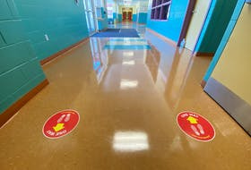 Directional arrows in hallways are meant to cut down on congestion in schools. TINA COMEAU PHOTO