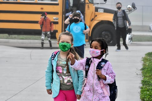 Students arrive masked at Yarmouth Elementary School for the first day of the 2020-2021 school year, which because of the COVID pandemic saw an opening day unlike any other. For students returning to school, Sept. 8 was their first day back in the classroom since leaving for March Break during the last school year. Students never returned to the classroom. TINA COMEAU PHOTO
